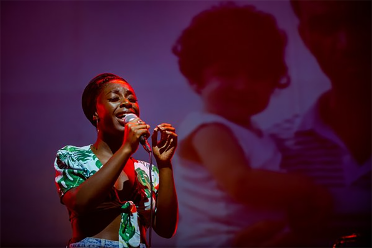 Photograph of a woman singing.